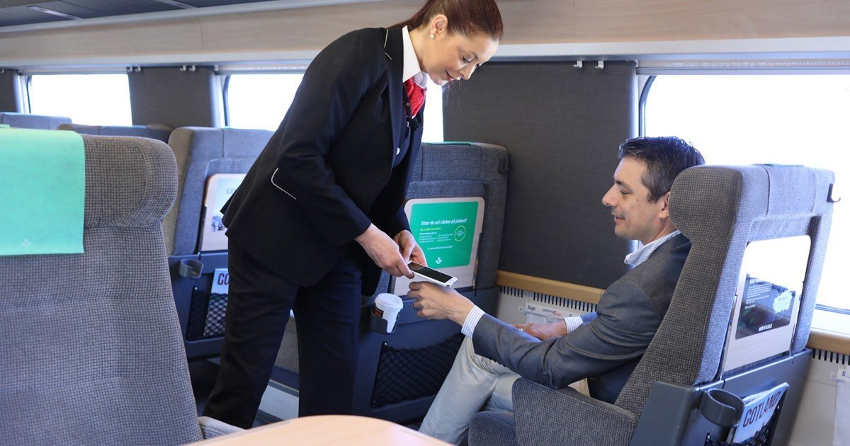 The man in the picture is paying for his rail ticket in Sweden through an implanted microchip